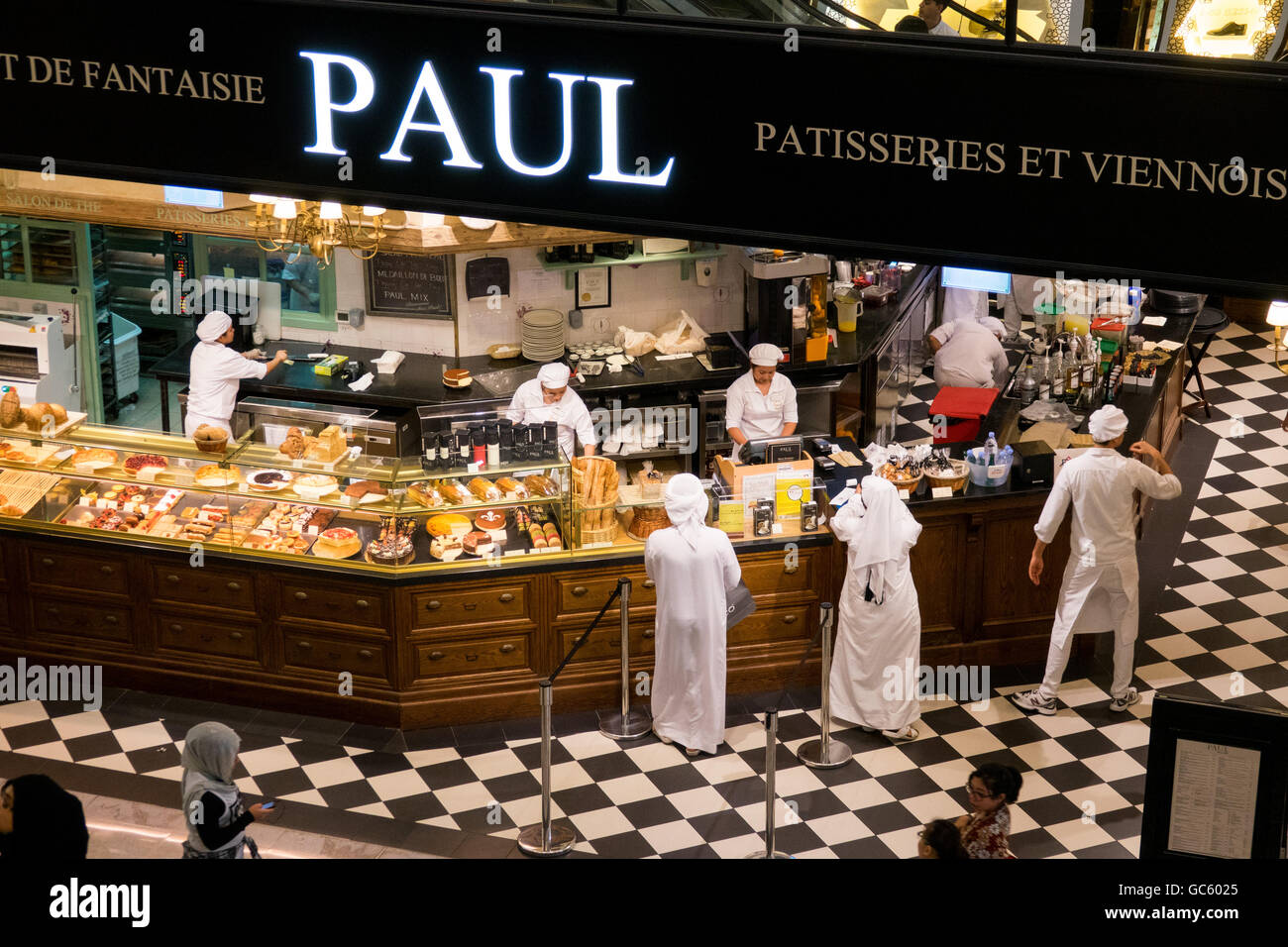 Muslims order at Paul Patisserie for Iftar during the holy month of Ramadan in Dubai - Stock Image