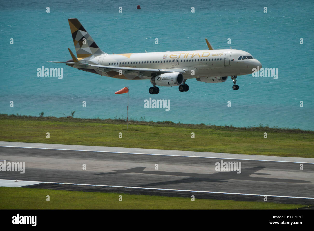 An Etihad Airlines Airbus A320 jet comes in to land at Mahe, Seychelles - Stock Image