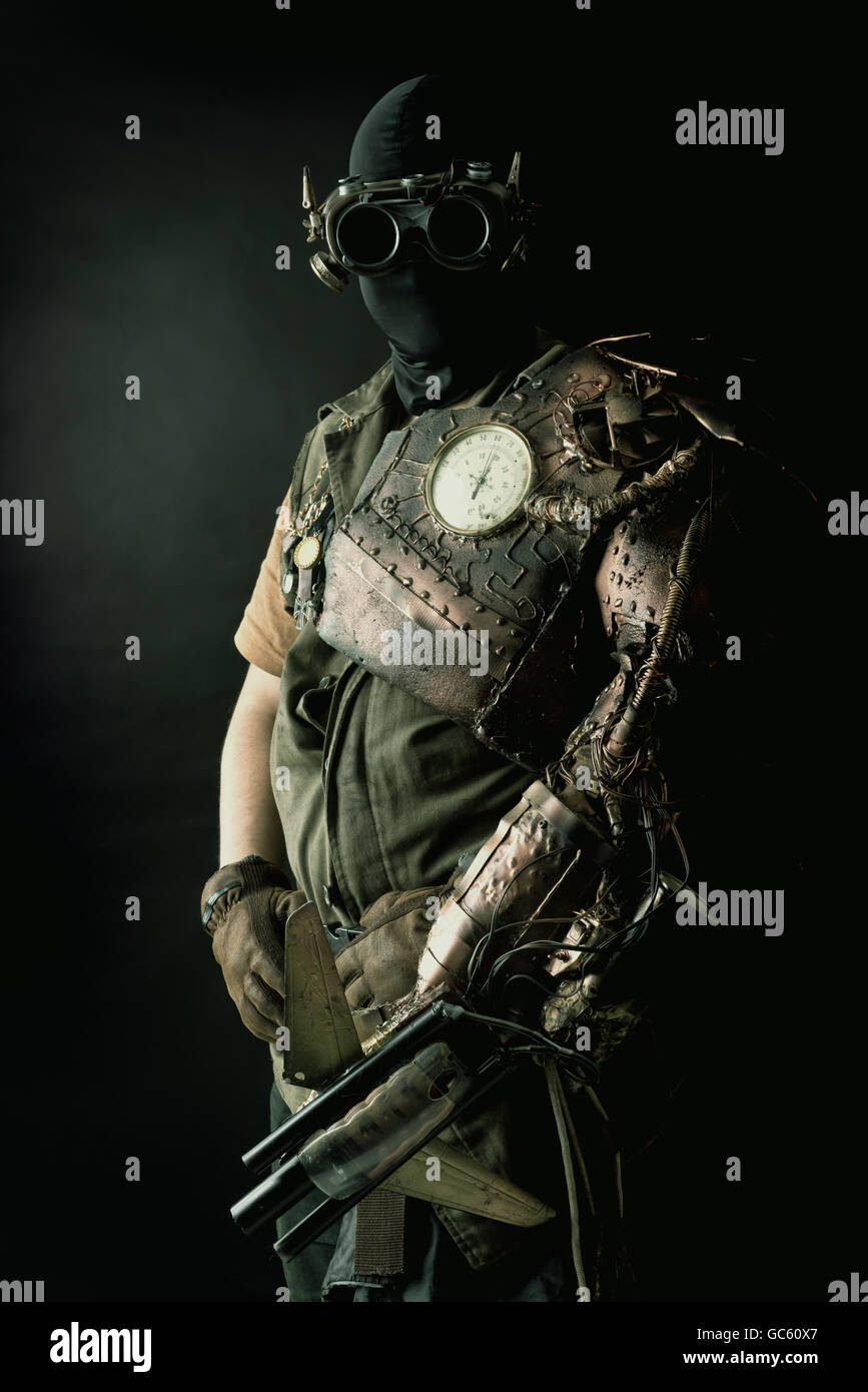 Futuristic soldier posing with gun and armor - Stock Image