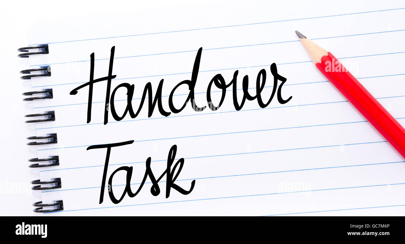 Handover Task written on notebook page with red pencil on the right - Stock Image