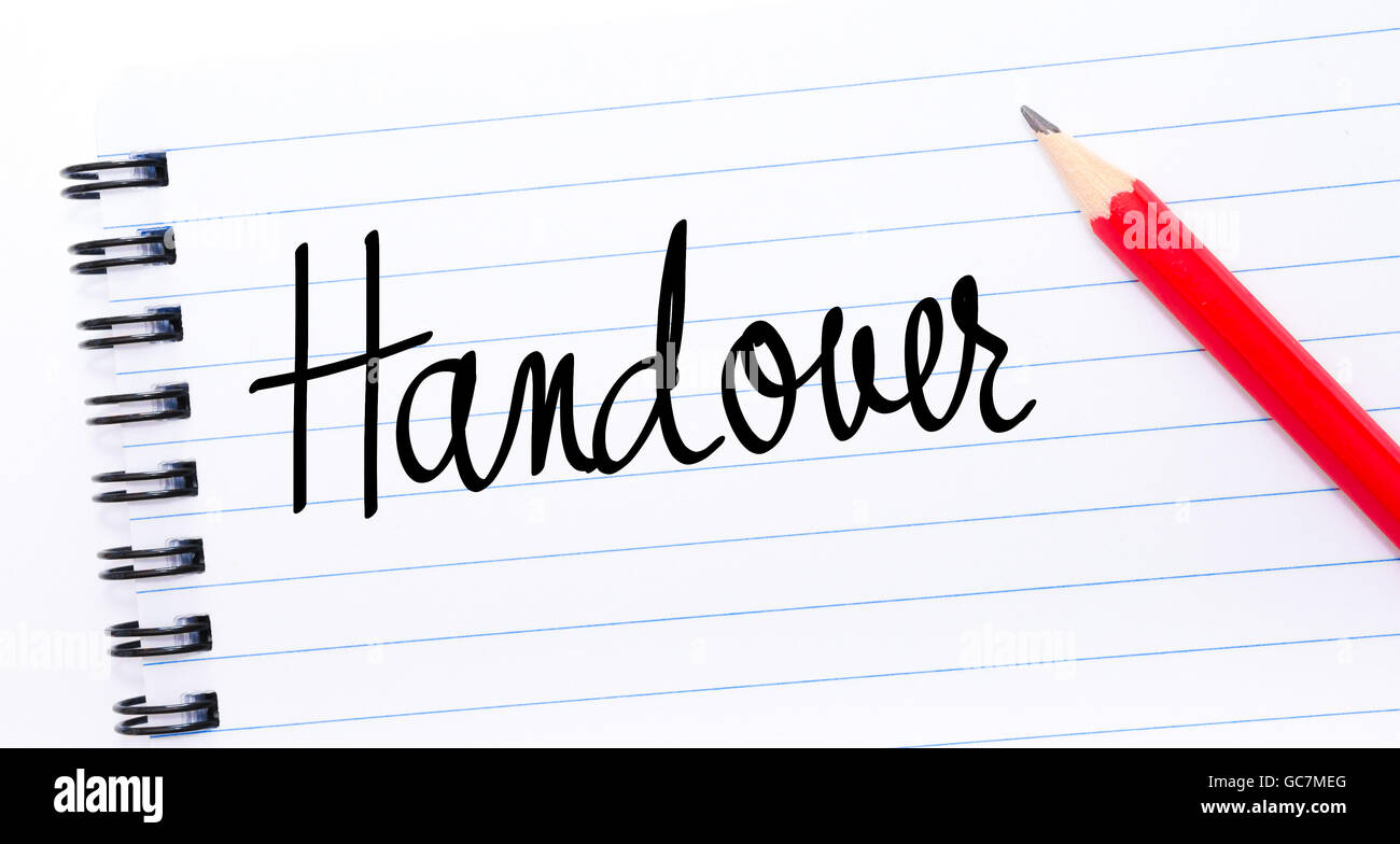 Handover written on notebook page with red pencil on the right - Stock Image
