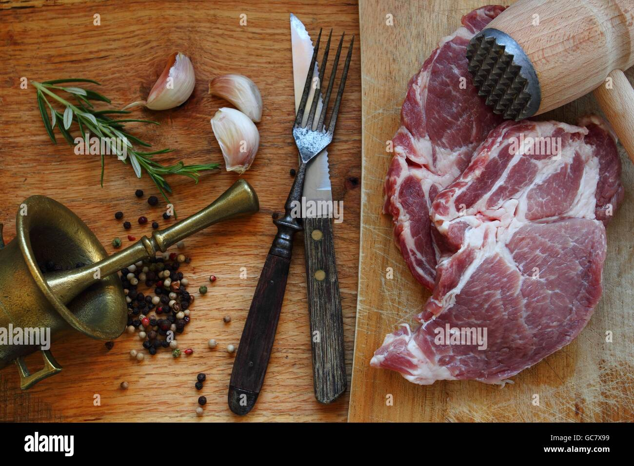 Raw meat. Pork steak with herbs - Stock Image