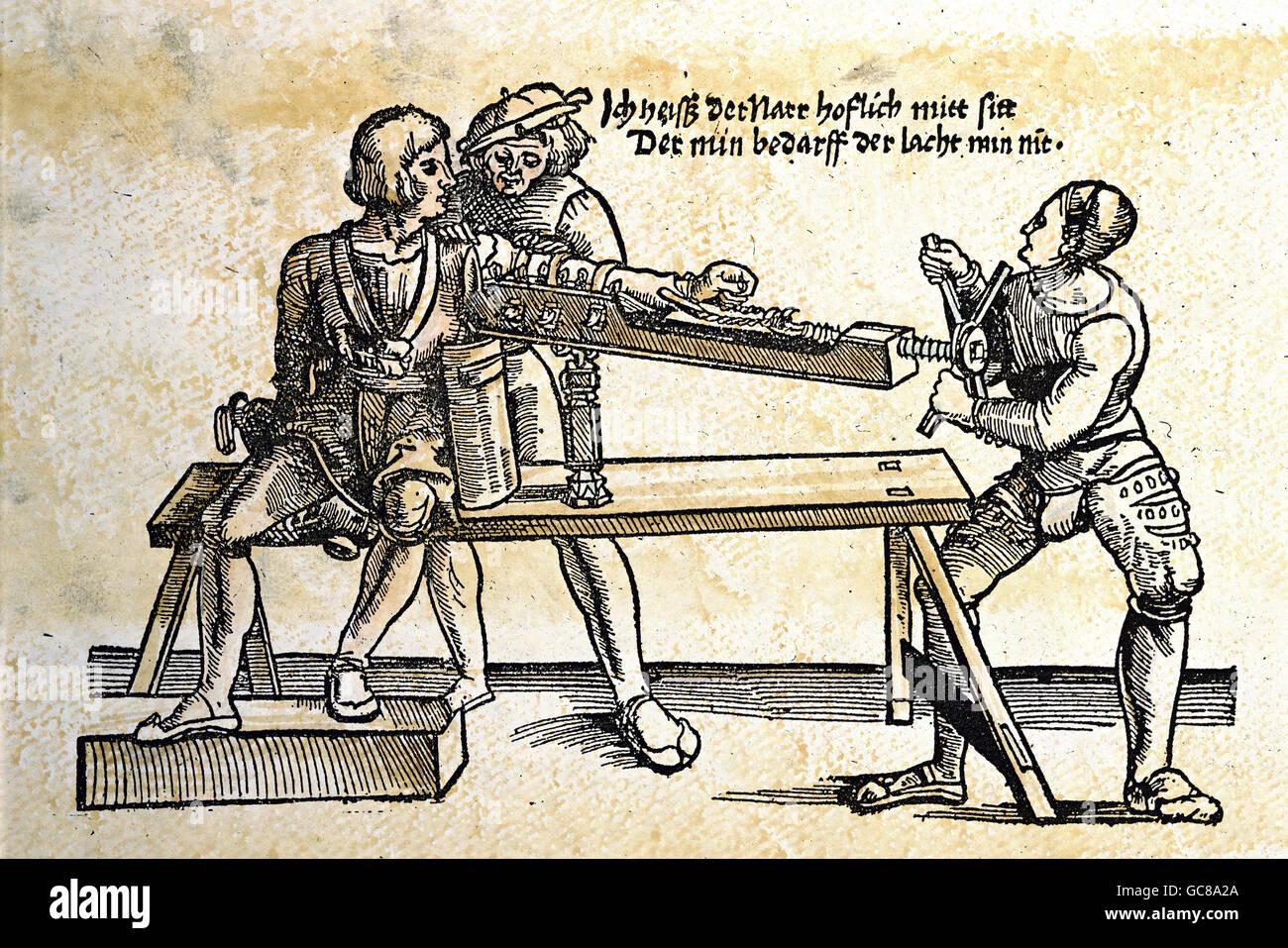medicine, treatment, treatment of an arm with a rack, woodcut, from 'Feldtbuch der Wundartzney', by Hans - Stock Image