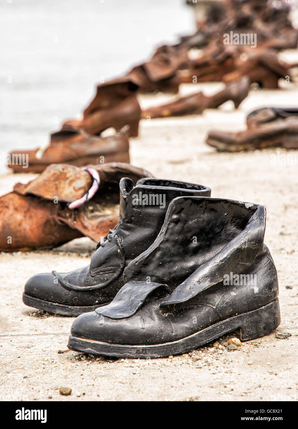 Shoes monument on the Danube bank is a memorial in Budapest, Hungary. Place of reverence. Cultural heritage. Symbolic - Stock Image