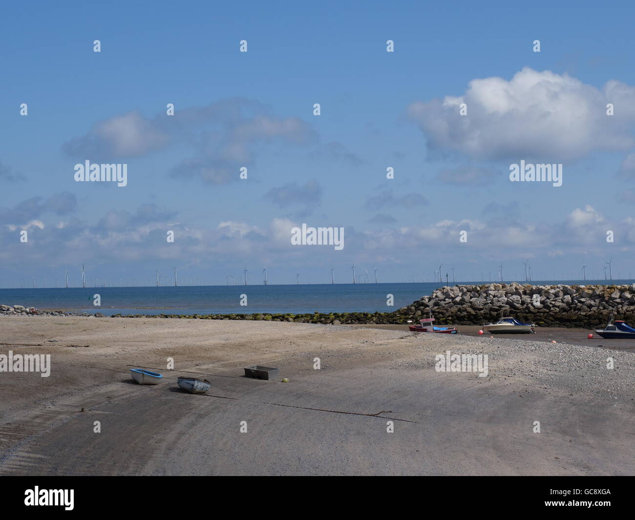 A beach in wales on a sunny day - Stock Image