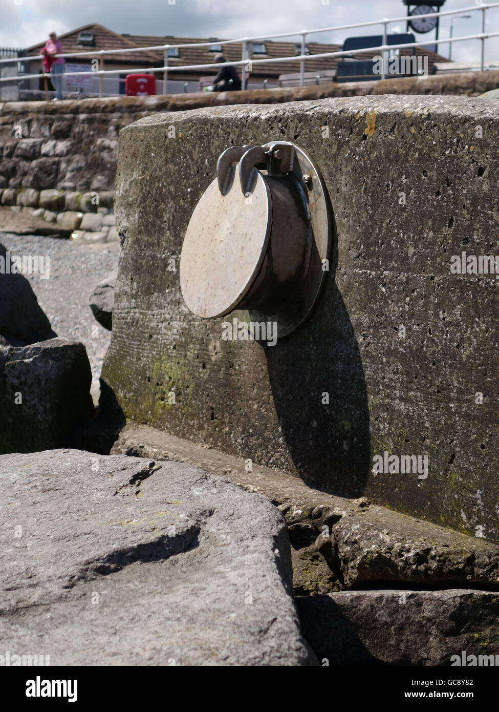 A unusual drainage pipe on a beach - Stock Image