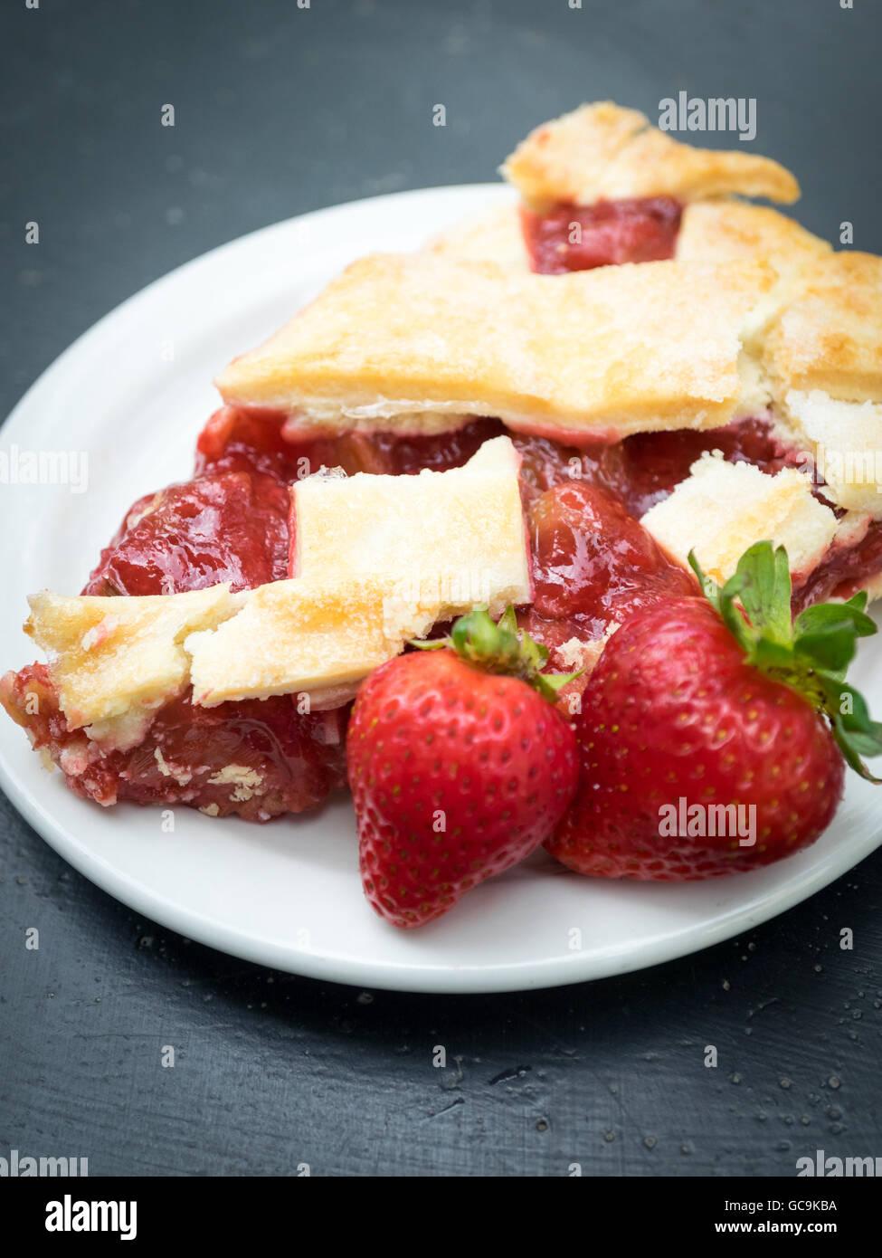 A slice of strawberry-rhubarb pie from Zuppa Café in Edmonton, Alberta, Canada. - Stock Image