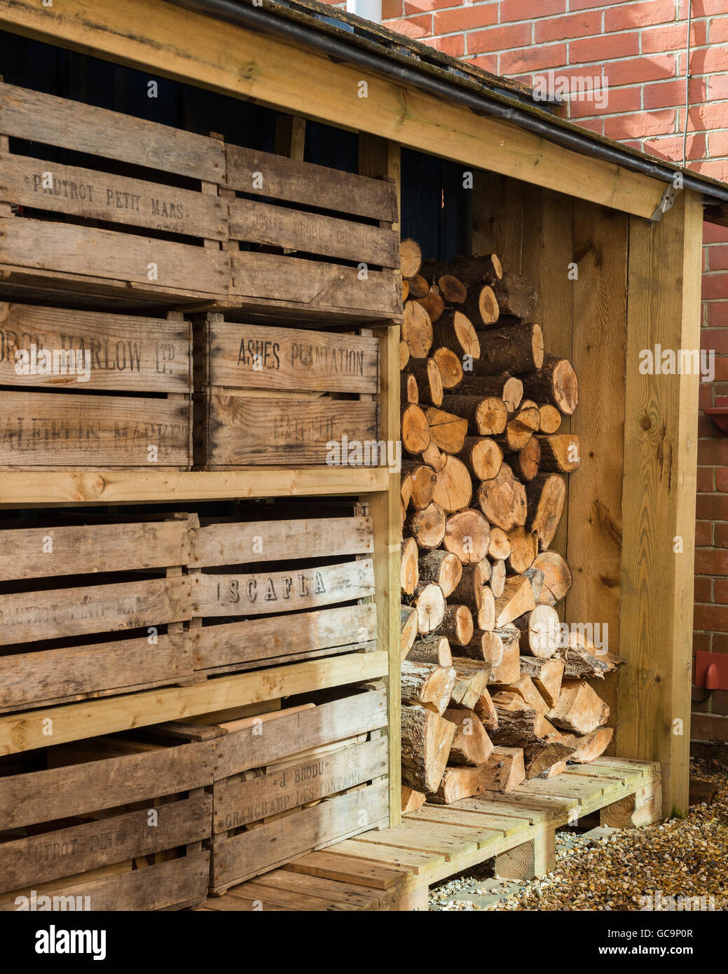 Outside log store complete with vintage fruit crates - Stock Image