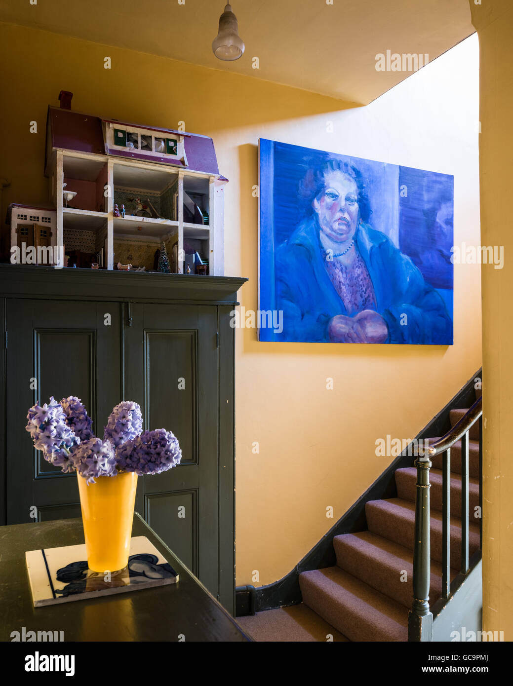 Large canvas with vintage dollshouse in staircase hallway of Nottinghill Victorian terrace, London, UK - Stock Image