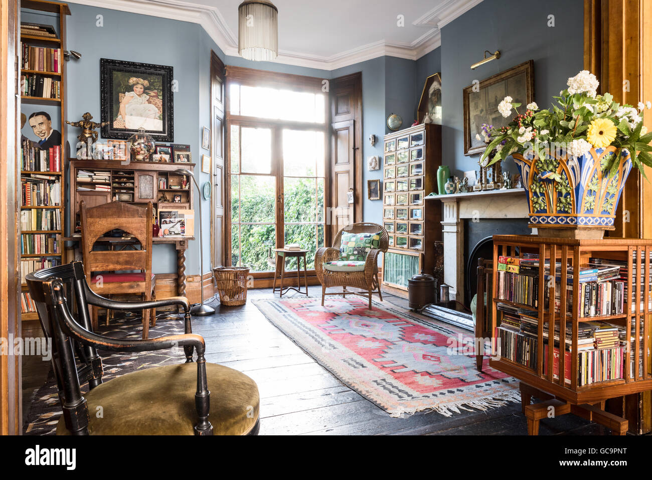 Arts and crafts style revolving bookcase in drawing room for Arts and crafts style
