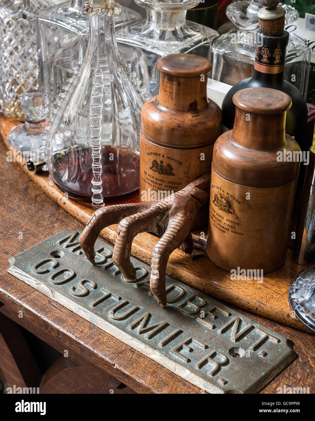 Antique homeware with metal sign in London apartment, UK - Stock Image