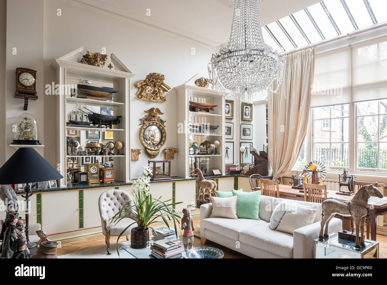 1920s glass chandelier in london apartment with 19th century ships 1920s glass chandelier in london apartment with 19th century ships mirror and nautical curios mozeypictures Gallery