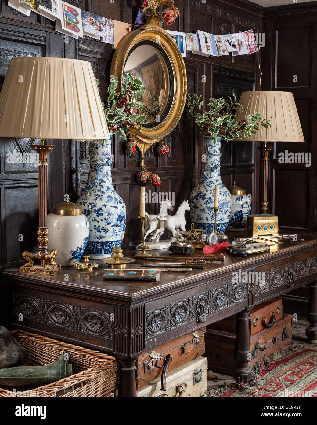 Christmas cards hang above regency mirror and Jacobean sideboard in ...
