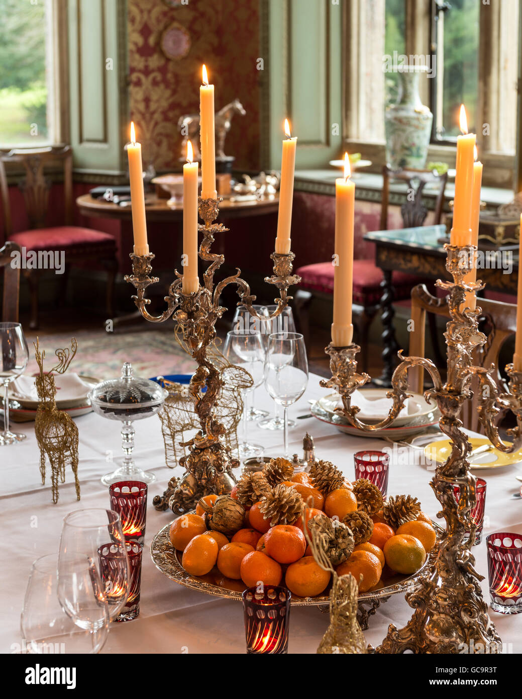 Gilded candlesticks on dining table in Grade I listed, Victorian Gothic Carlton Towers, East Riding - Stock Image