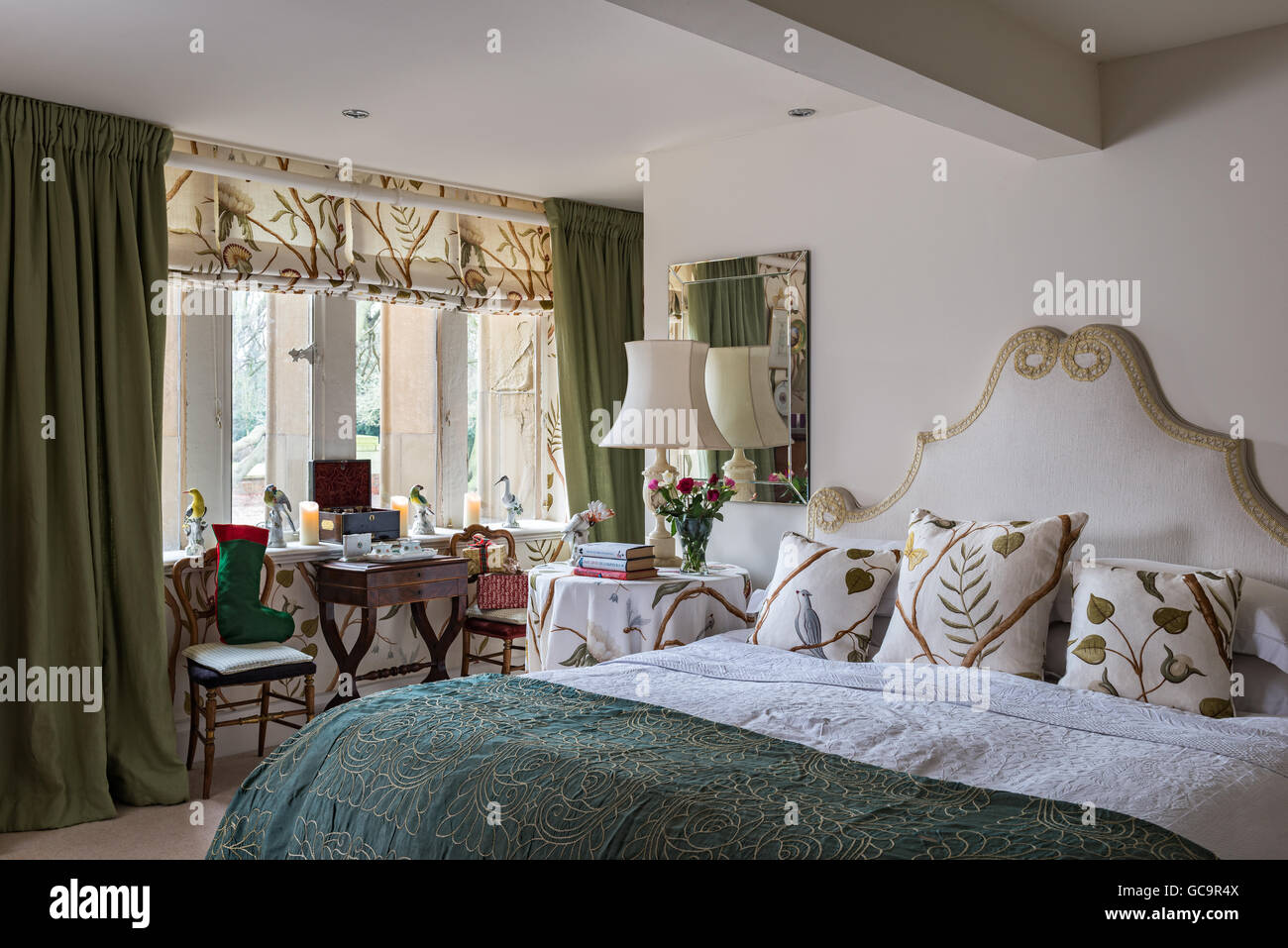 Coordinated fabric and wallpaper in master bedroom of Grade ...