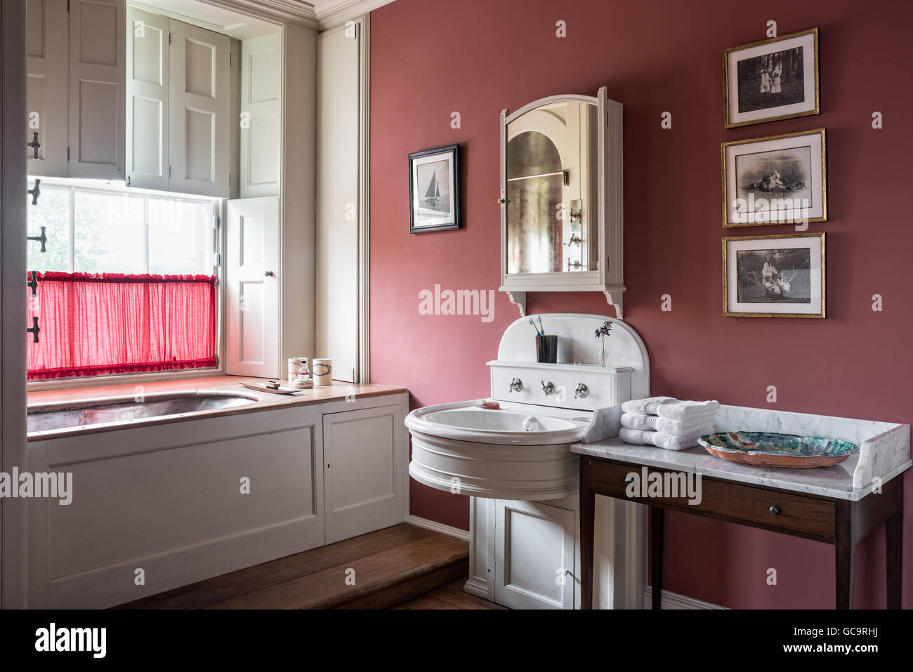 Bathroom with original fittings and marble topped washstand - Stock Image