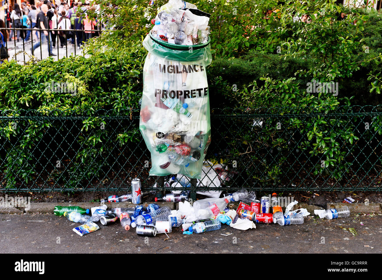 full trash can in Paris, Montmartre - Stock Image