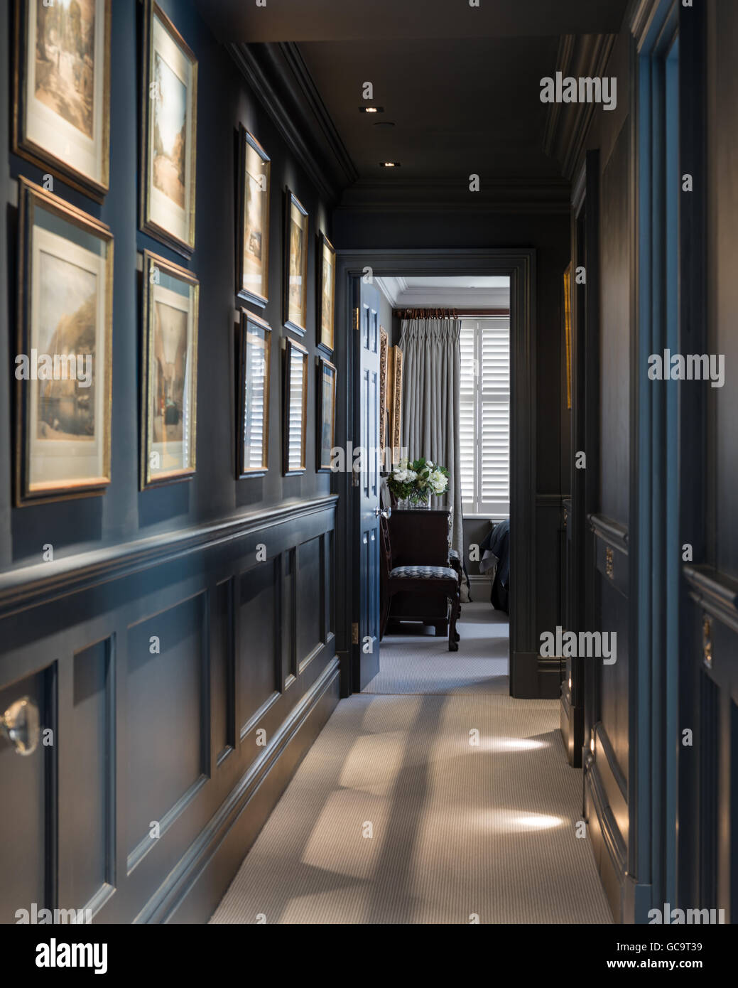 Hall walls painted in Hicks Blue by Little Greene - Stock Image