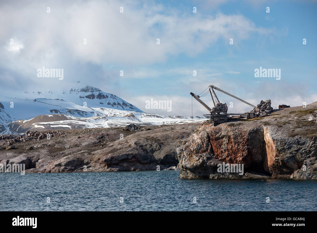 Disused crane at the ruins of the marble quarry at Ny London, Kongsfjorden, Spitsbergen, Svalbard Islands, Norway - Stock Image