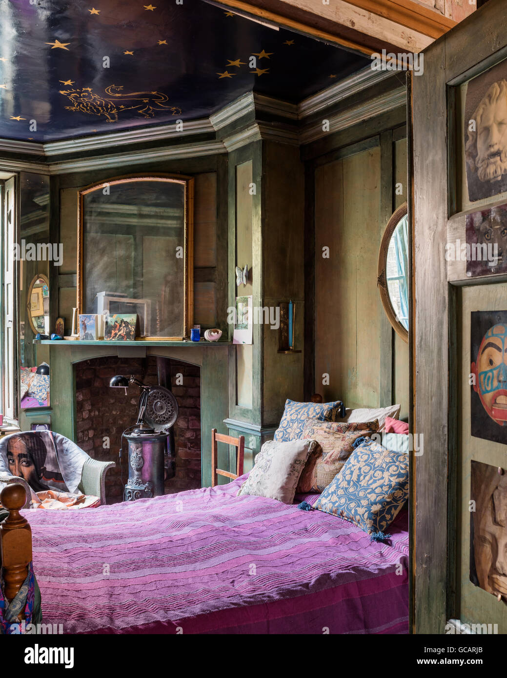 Quirky green wood panelled bedroom with celestial ceiling ...