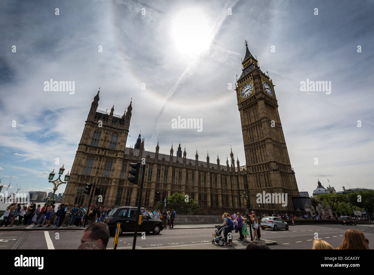 A solar halo seen over Westminster's Parliament buildings and Big Ben, London, UK. Stock Photo