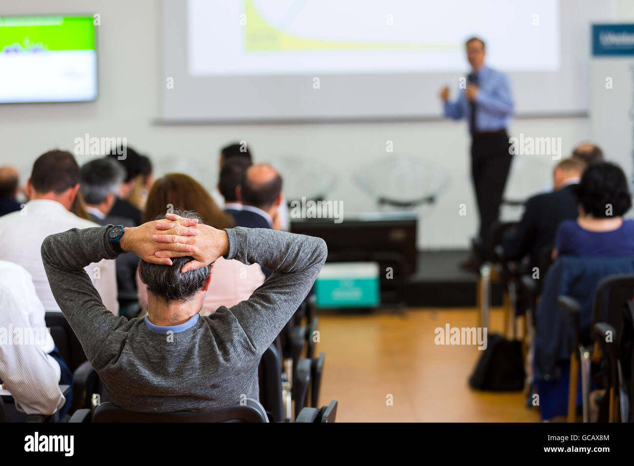 Business man during a conference presentation - Stock Image