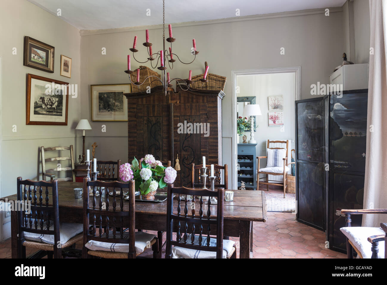 18th Century Oak Table And Yorkshire Chairs In Dining Room With Terracotta Flooring Painted Austrian Cupboard Ceiling