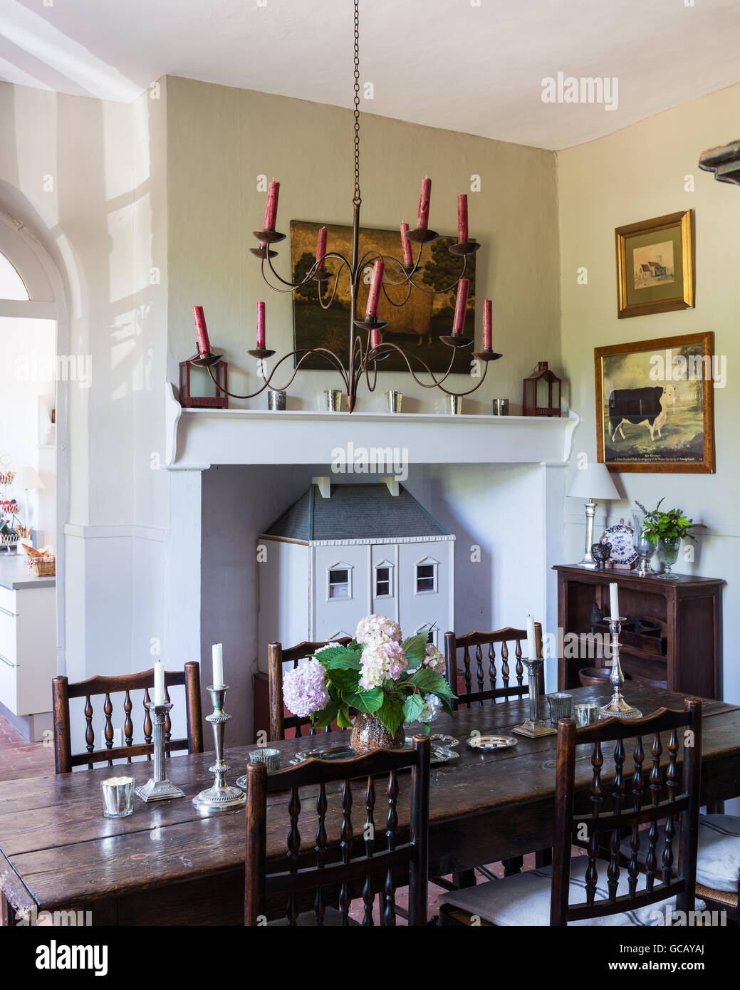 18th Century Oak Table And Yorkshire Chairs In Dining Room With Terracotta Flooring Ceiling Candelabra