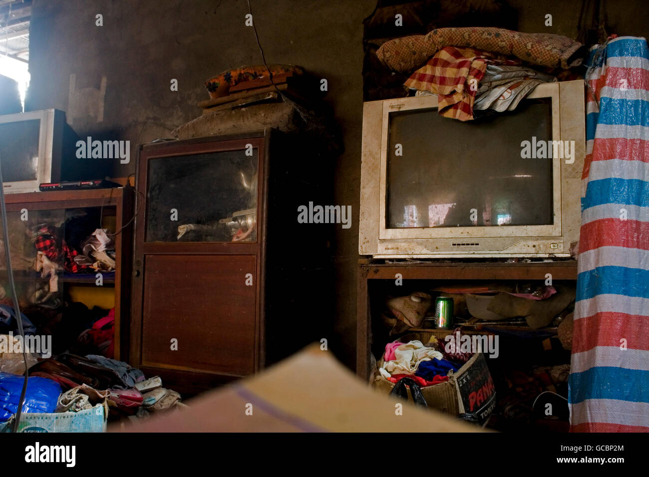 An old Pixel Plus brand multi player sits on a shelf in messy house in Chork Village, Cambodia. - Stock Image