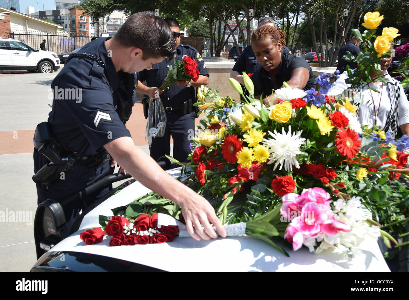 Flowers at dallas police headquarters stock photos flowers at dallas texas usa 8th july 2016 dallas police officers shortly before izmirmasajfo