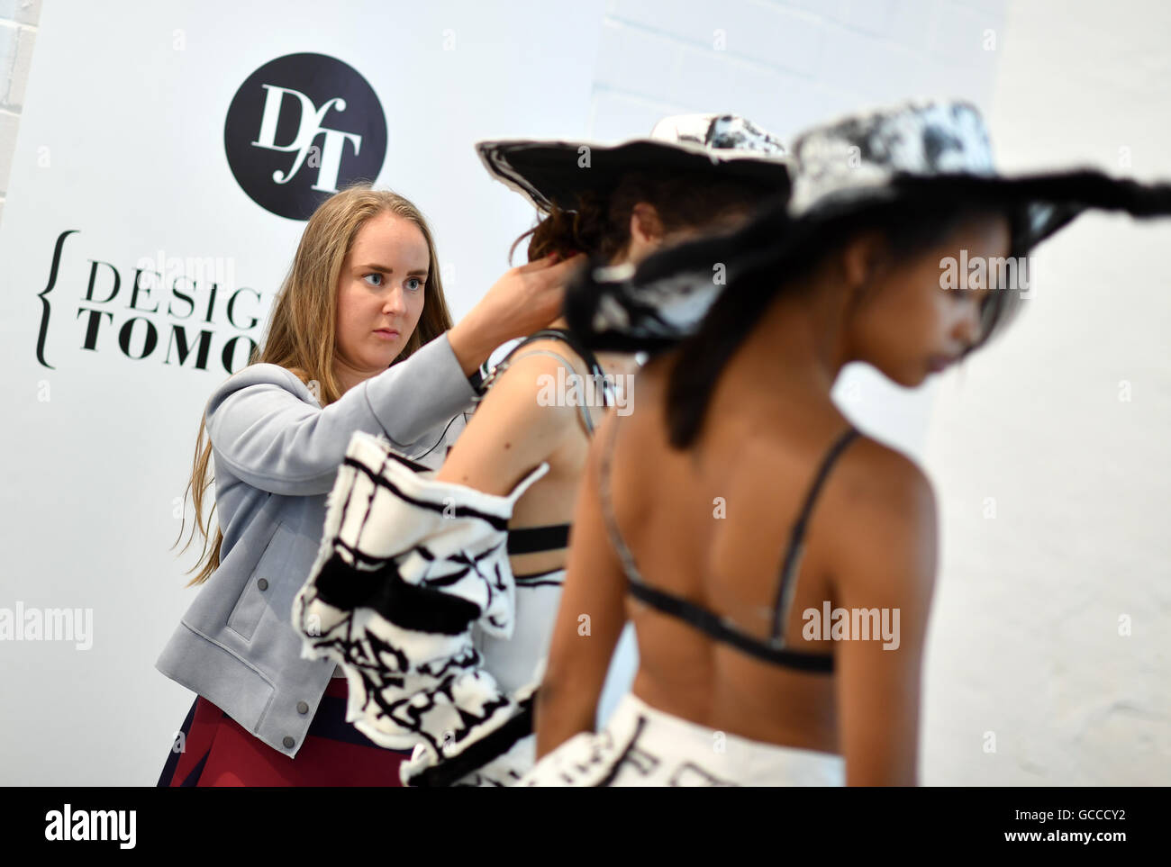 Berlin, Germany. 27th June, 2016. A model is dressed into a creation of Norwegian designer Edda Gimnes during the Stock Photo