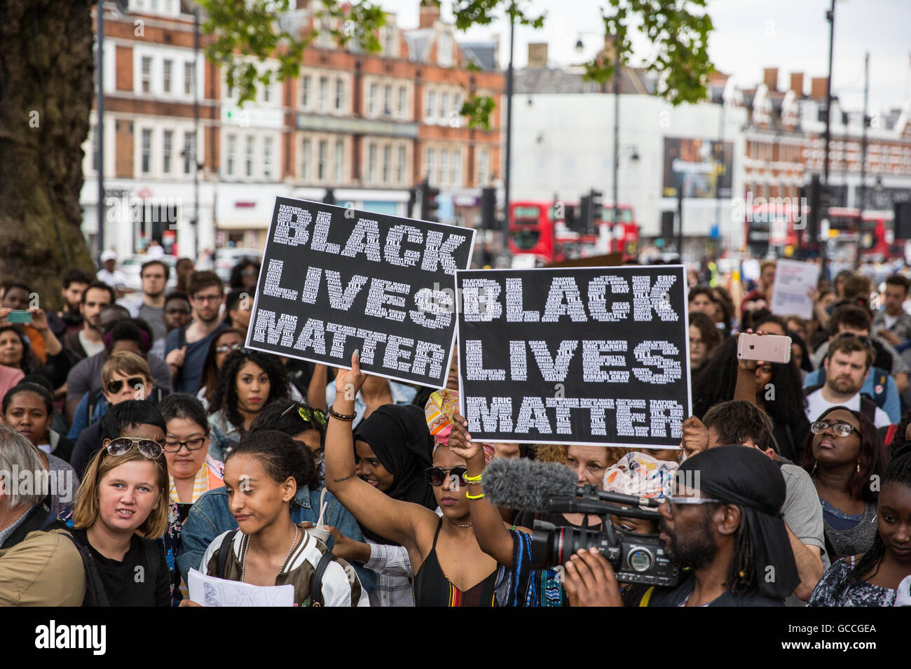 London, UK. 9th July, 2016. Campaigners hold Black Lives Matter signs at a rally in Brixton in solidarity with Alton - Stock Image