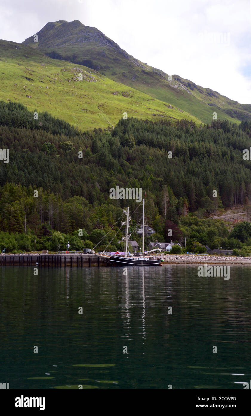 Brigantine Square Rigged Ship 'Lady of Avenel' Moored under the Scottish Mountain Corbett Sgurr Coire Choinnichean, - Stock Image