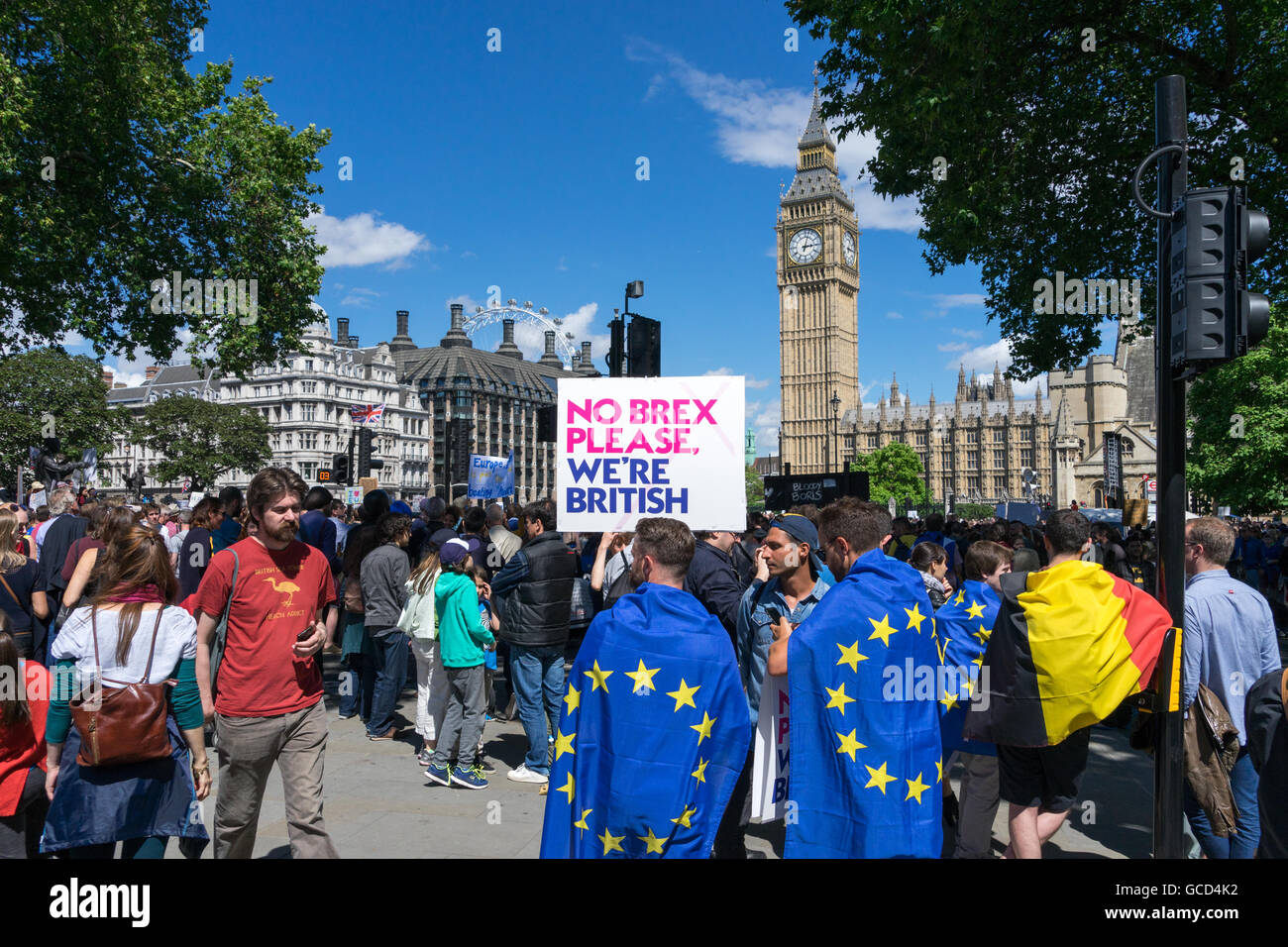 Anti- Brexit protestors wave banners against the UK Governments decision to leave European Union, crowds on street - Stock Image