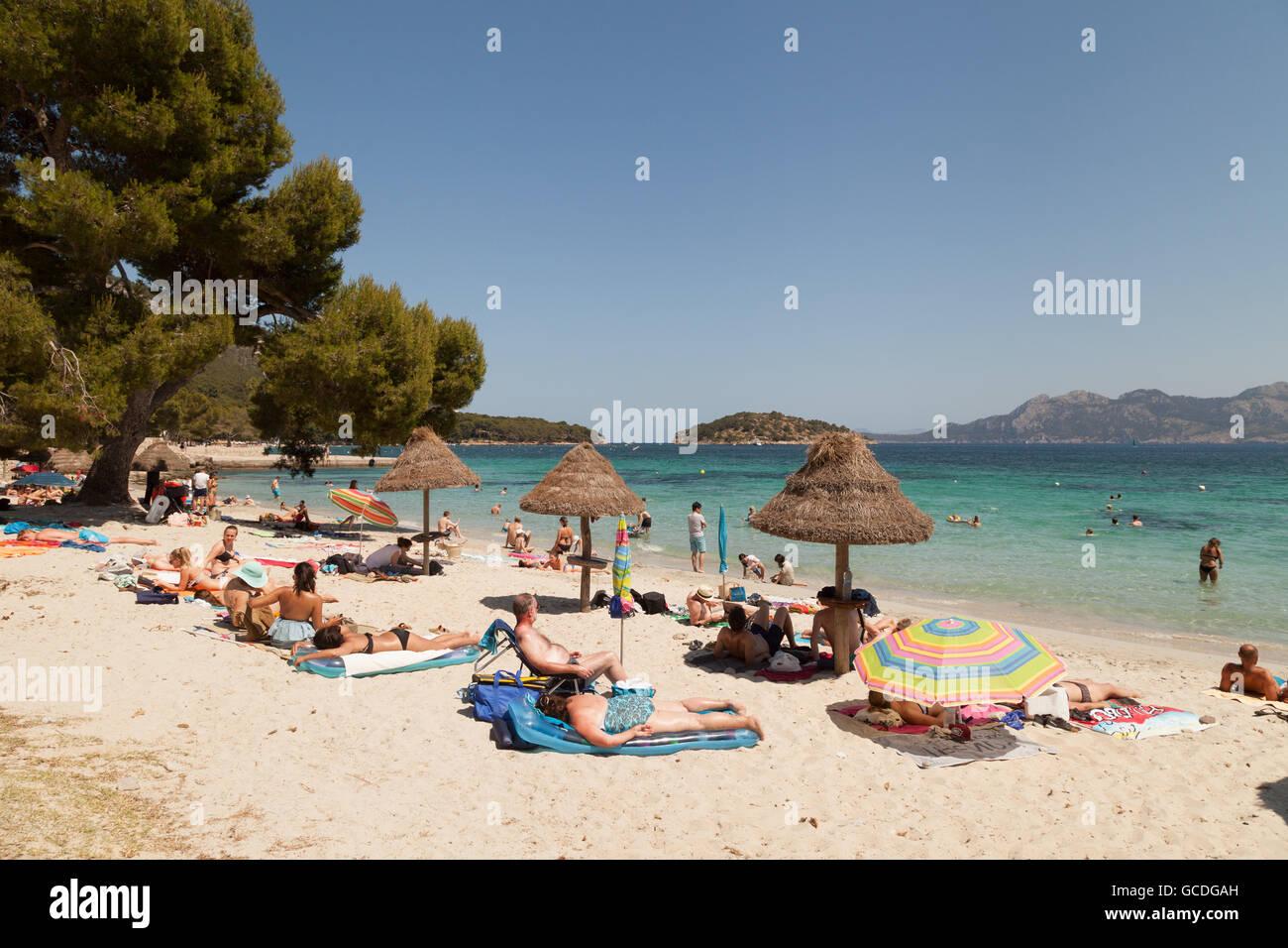 Sunbathers on Cala Formentor beach, north coast, Mallorca ( Majorca ), Balearic Islands, Spain Europe - Stock Image