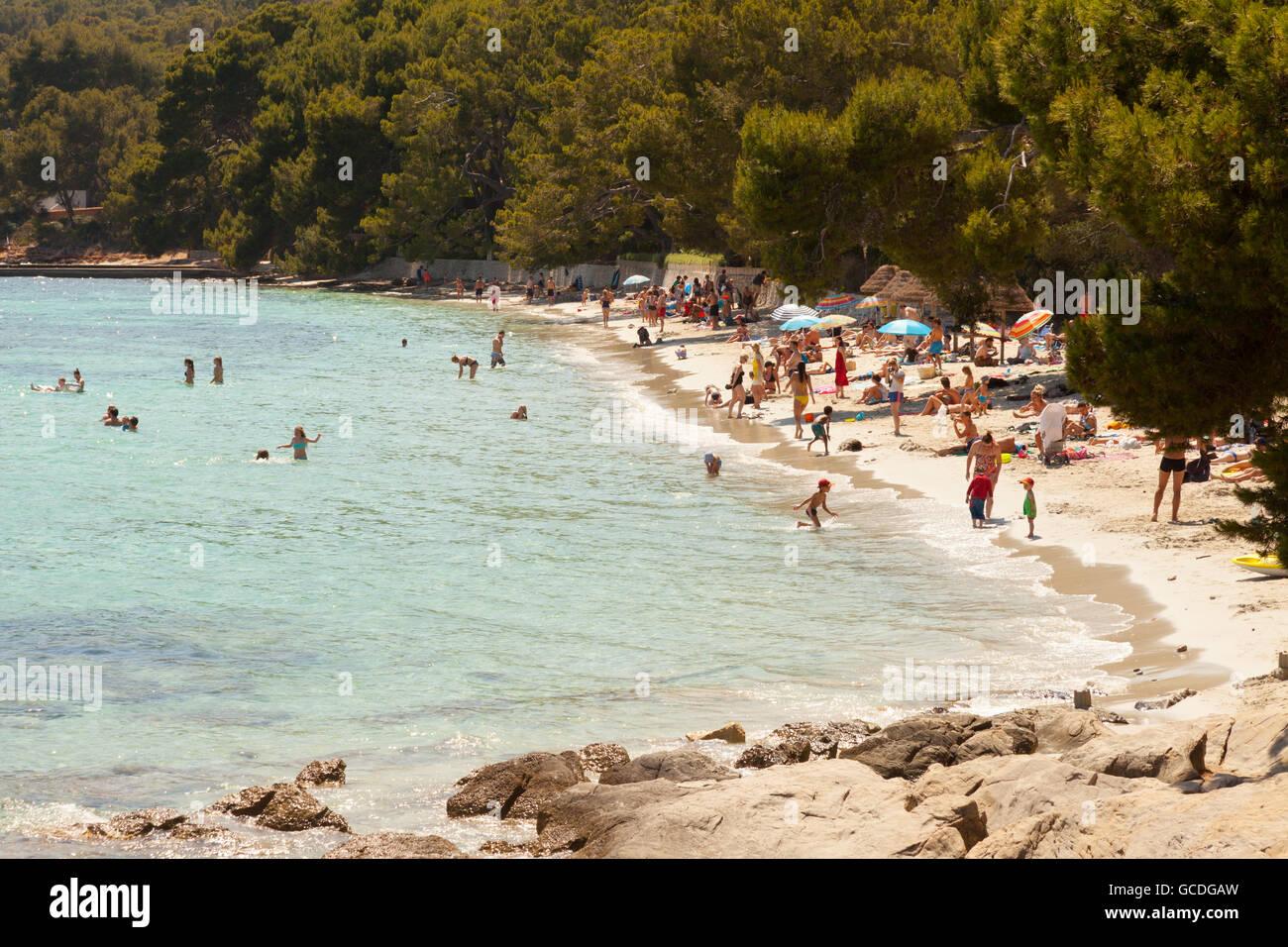 People on the beach at Cala Formentor beach, north coast, Mallorca ( Majorca ), Balearic Islands, Spain Europe - Stock Image