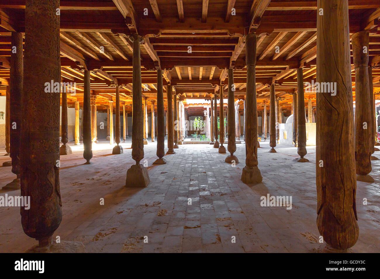 Wooden columns of the Juma Mosque in Khiva, Uzbekistan. - Stock Image