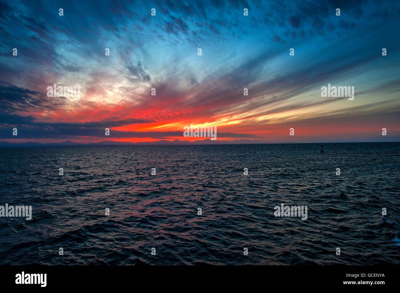 Sunset, ripples in ocean, Red Sea, Egypt - Stock Image