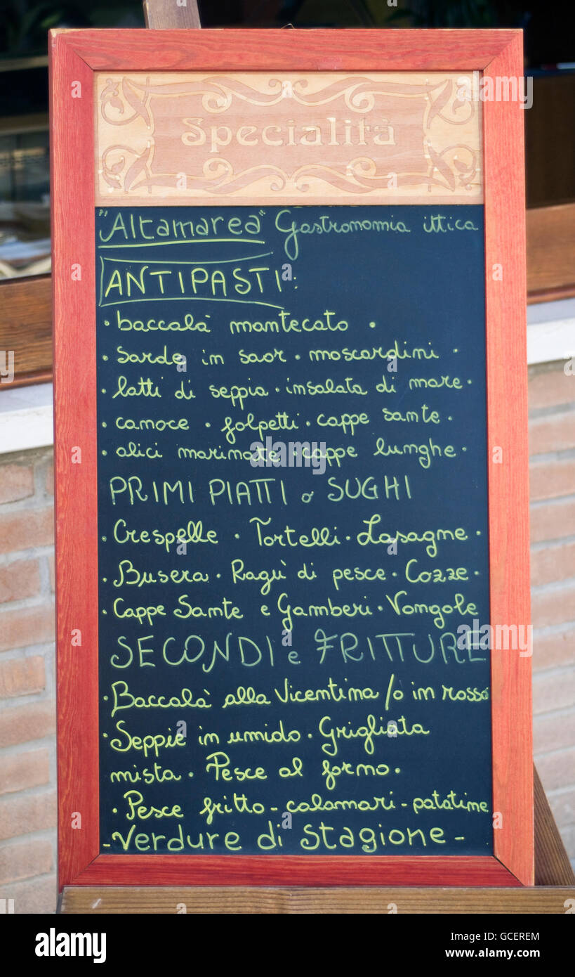 Handwritten Blackboard Menu Sign Outside Italian Restaurant In Stock