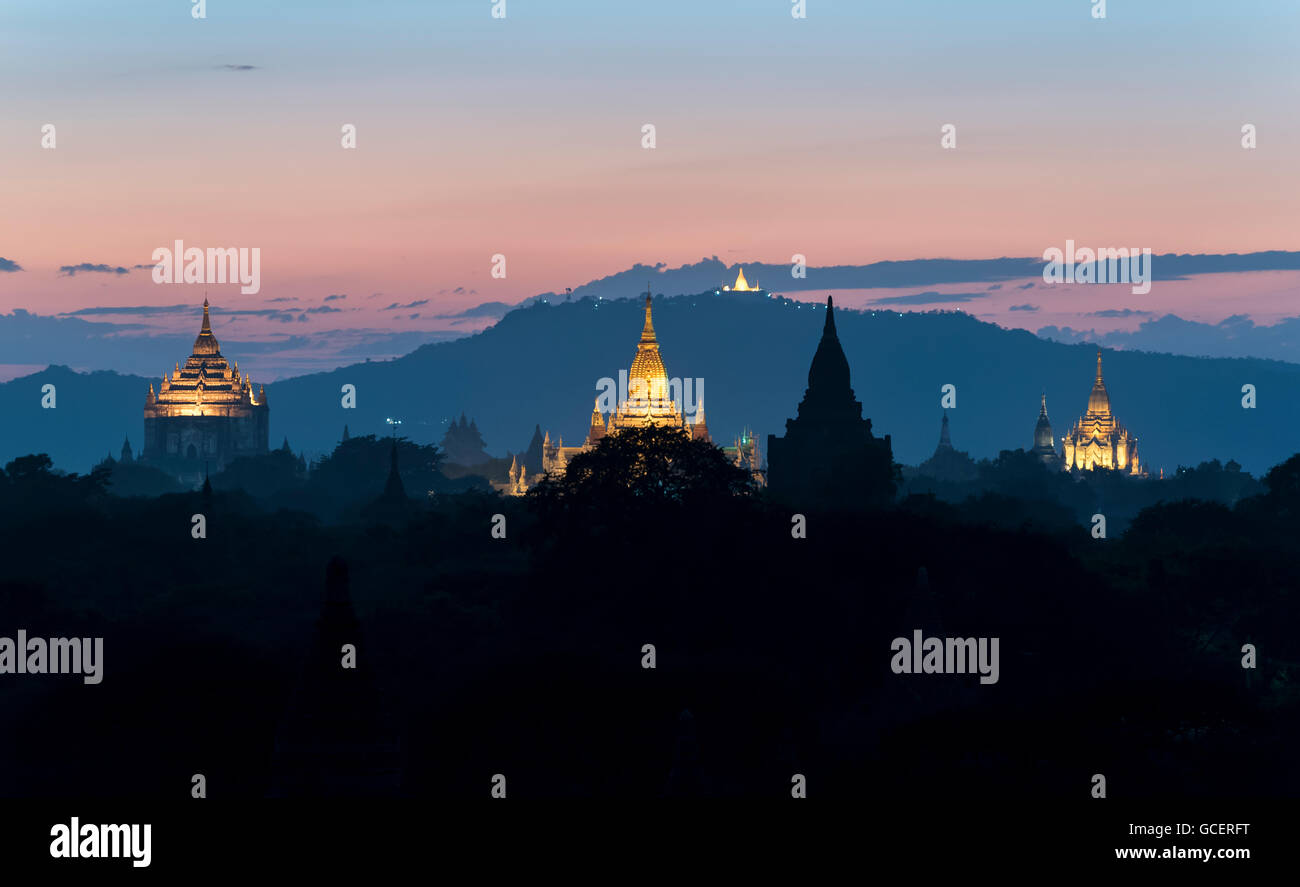 View of Thatbyinnyu temple, Ananda temple and other temples at dusk, Old Bagan, Myanmar - Stock Image