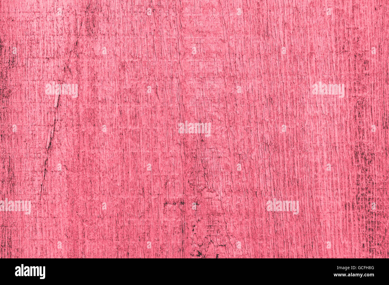 Rough grainy wood mainly red reddish grayish colors - Stock Image