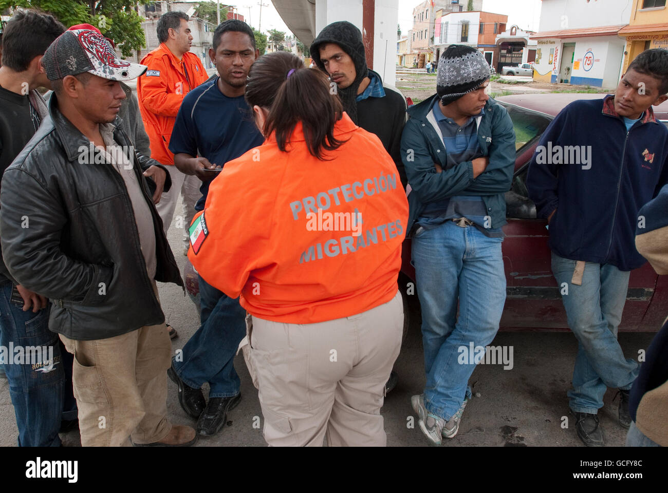 Local government agencies and officials attempt to orient and help Central American migrants passing through central - Stock Image