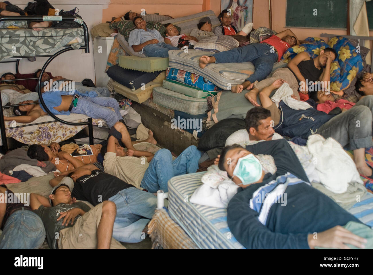 Central American migrants live together at a shelter in Tultitlan, Mexico in extremely overcrowded conditions. - Stock Image