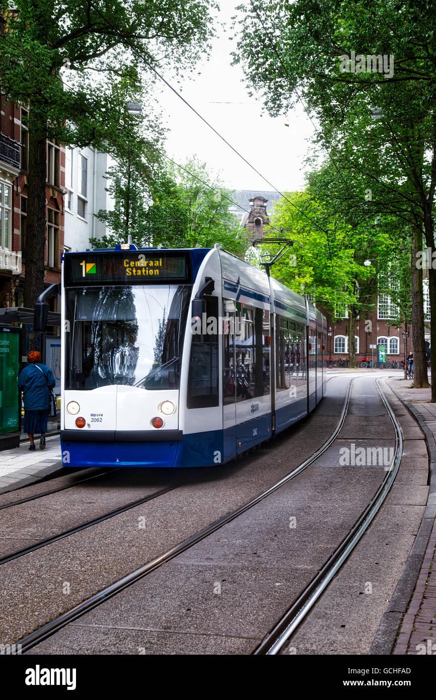 A light rail train on the tracks on a street amsterdam netherlands a light rail train on the tracks on a street amsterdam netherlands mozeypictures Choice Image