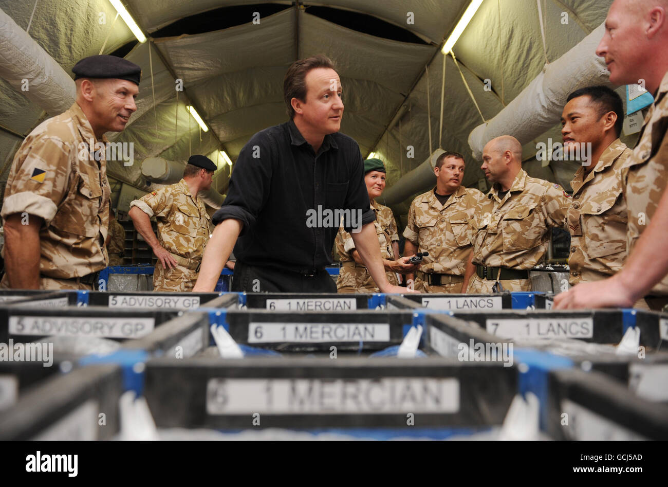 Prime Minister David Cameron meets soldiers work in the post office at Camp Bastion in Helmand Province during his two day visit to Afghanistan. Stock Photo