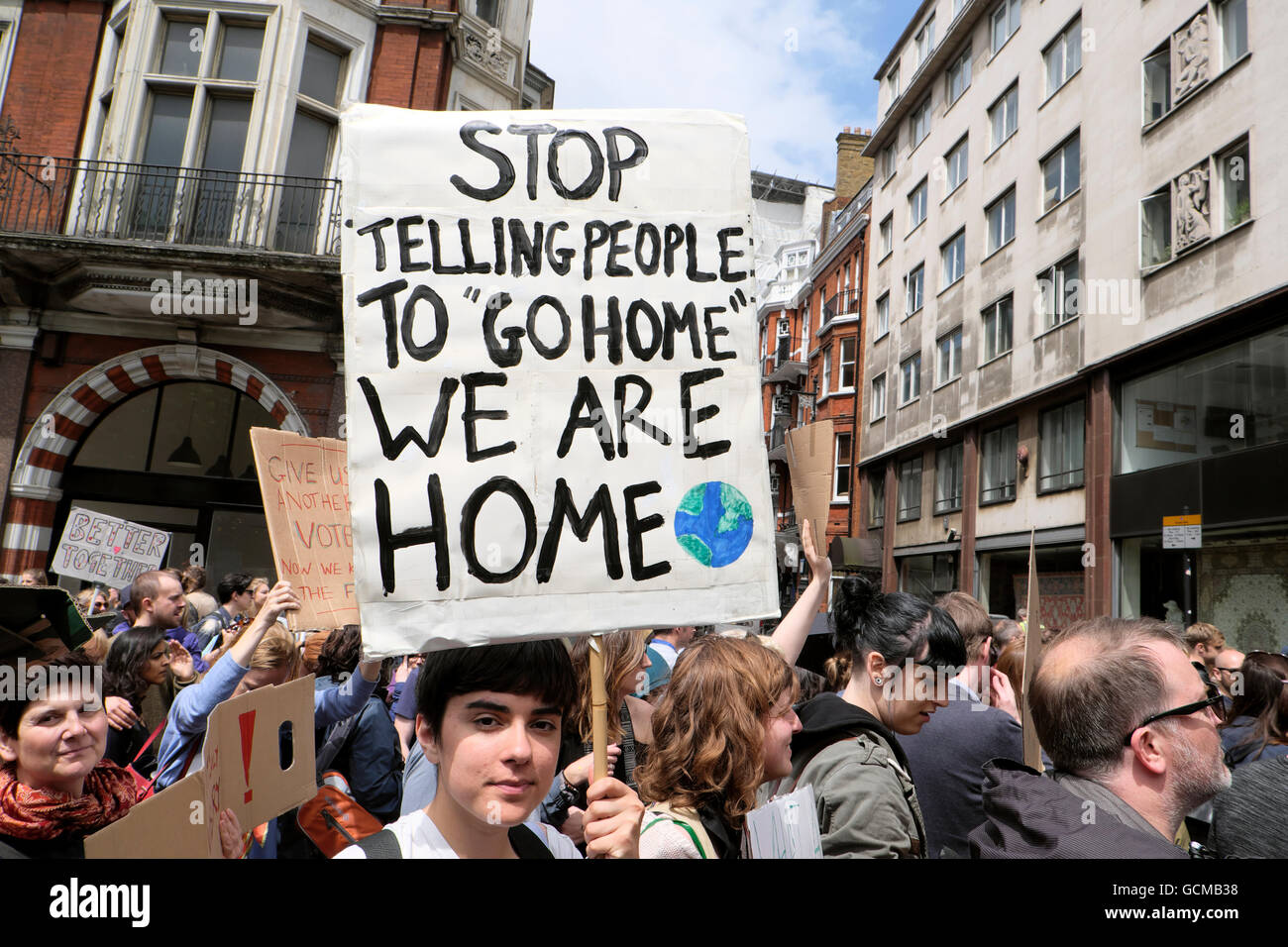 Stop Telling People to  'GO HOME'  sign  'WE ARE HOME'  poster at the  'March for Europe' - Stock Image