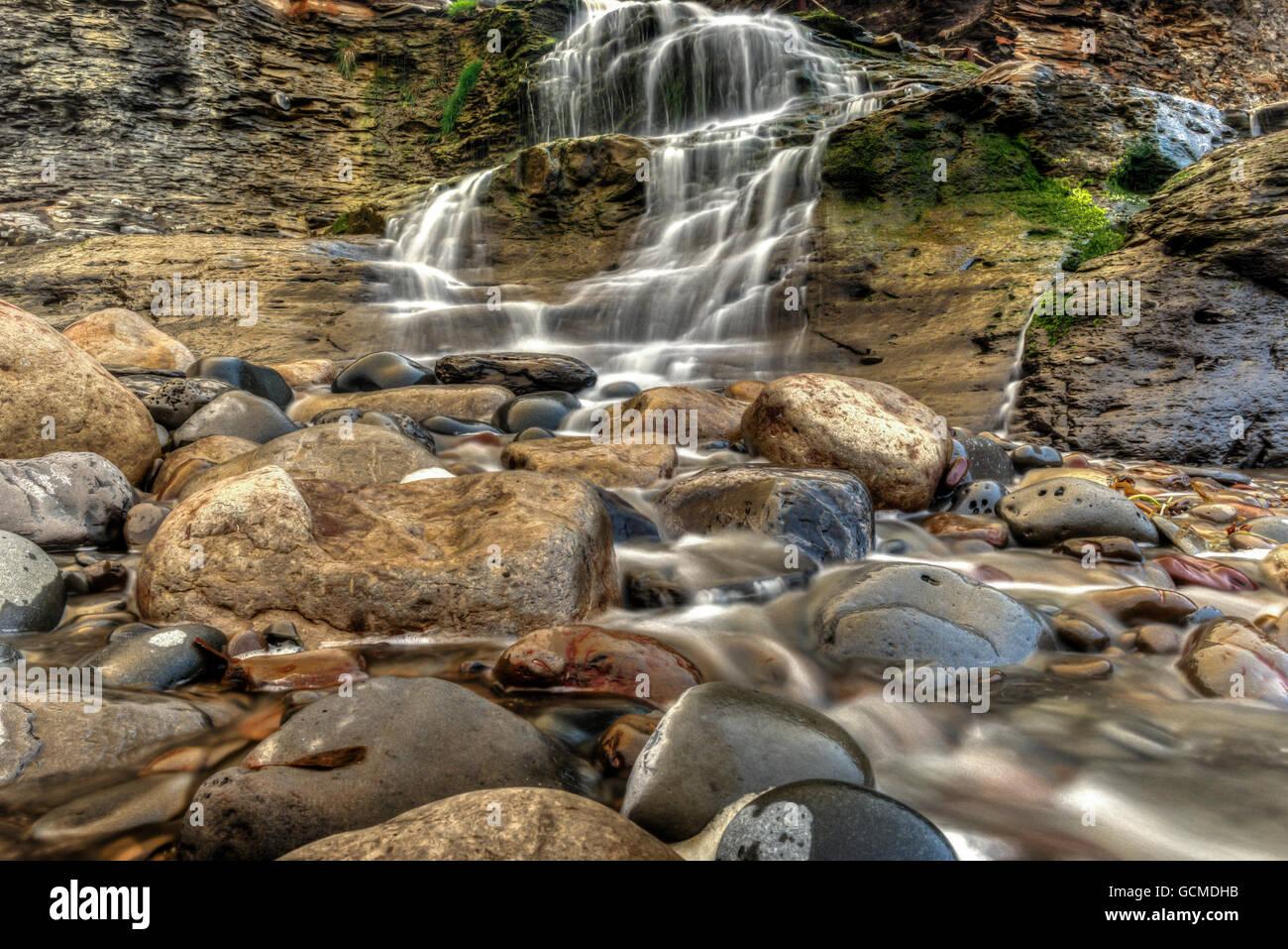 Beach Waterfall - Stock Image