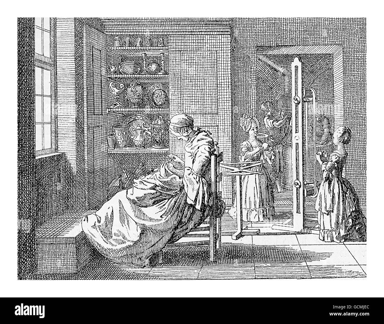 XVIII century, family life in Prussian upper class family: girls dressed as little woman help with domestic chores - Stock Image