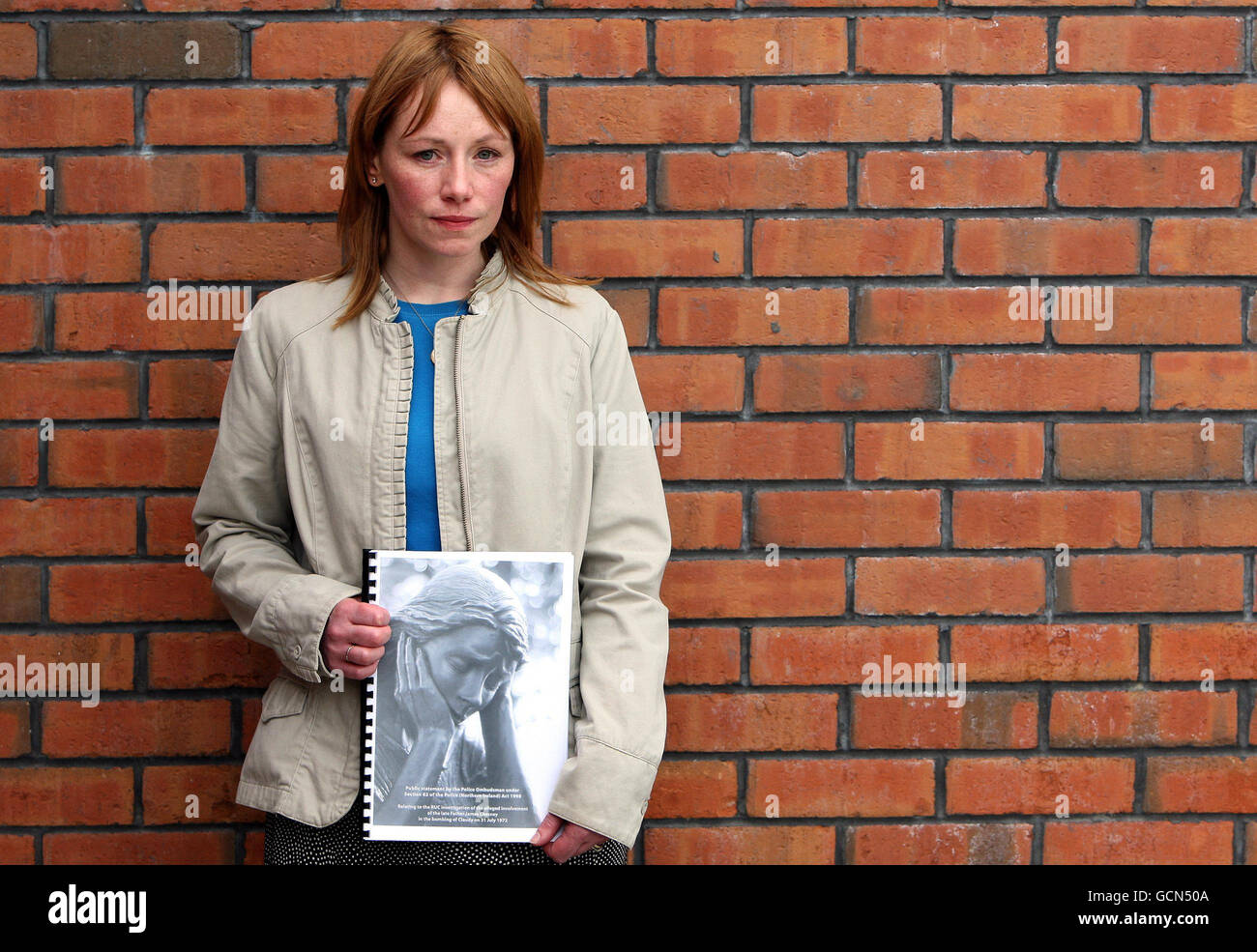 Family member Tracey Deanes, who lost her uncle James McClelland, with the Ombusman report into those killed in Stock Photo