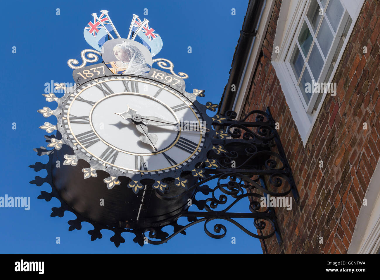 The Tolsey clock in Wotton-under-Edge celebrating the Jubilee of Queen Victoria's reign in 1897. - Stock Image